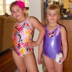 Kinsey and Caitlin show off their gymnastics outfits